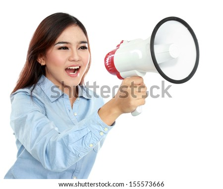 Young attractive  asian woman shouting with a megaphone