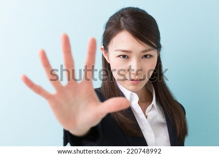 young attractive asian woman to refuse - stock photo