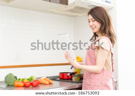 young attractive asian woman who cooks