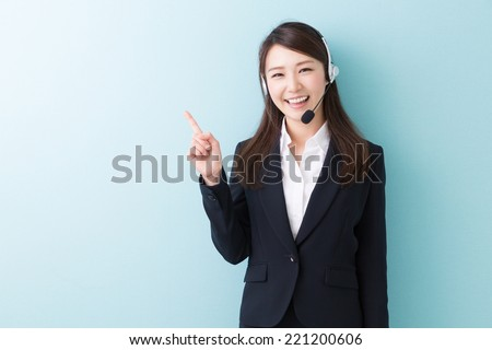 young attractive asian woman who works as an operator - stock photo