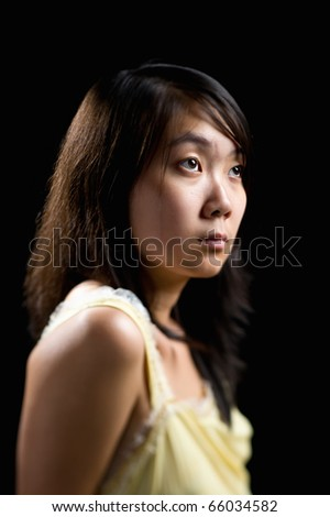 young attractive asian woman with only her eyes in clear focus - stock photo