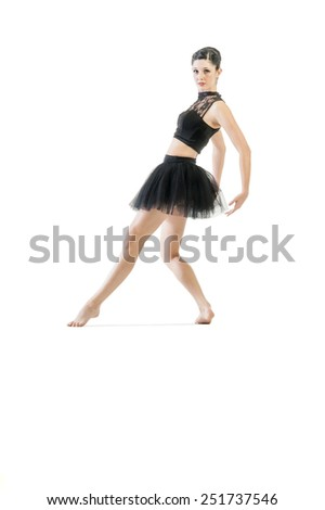 Young attractive ballerina doing alternate dance moves
