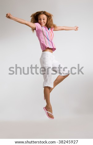 Young attractive blond jumping with hair flying - stock photo
