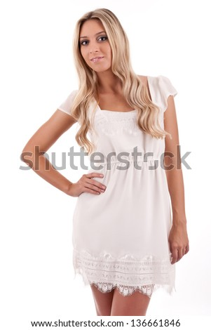 Young attractive blonde on light background - stock photo