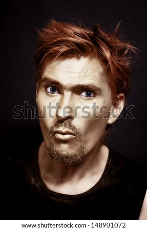 young attractive blue-eyed men with gold makeup and red hair