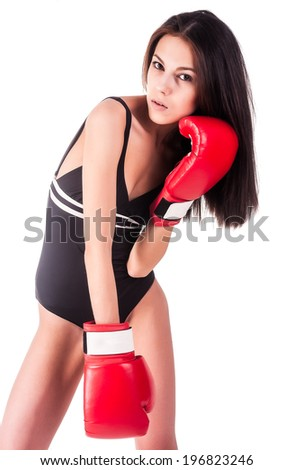 Young attractive boxer woman with red boxing gloves over white background - stock photo