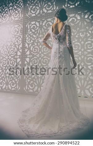 Young attractive bride. Portrait of beautiful bride. Wedding dress. Wedding decoration. Retro style. - stock photo