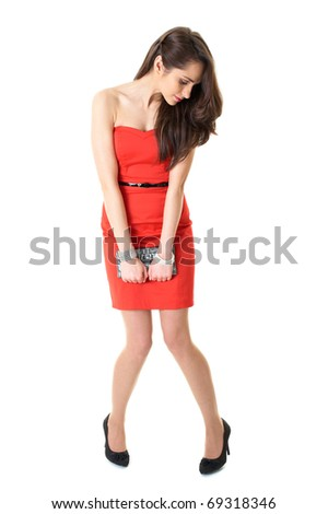 young attractive brunette female in red strapless dress, isolated on white background - stock photo