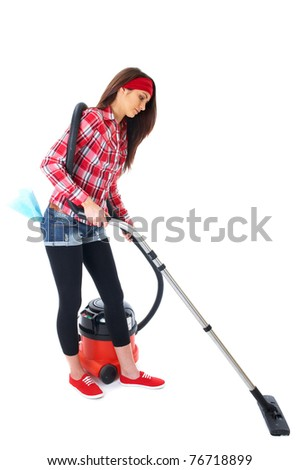 young attractive brunette female uses vacuum cleaner, isolated on white - stock photo