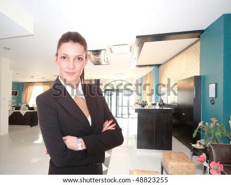 Young Attractive brunette Receptionist, At A Hotel Check In