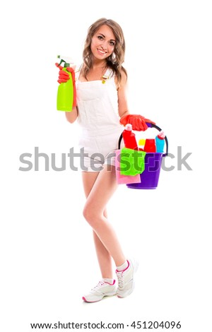 Young attractive brunette woman wearing rubber gloves holding a spray for cleaning glass in hand, isolated on white background. Cleaning concept. - stock photo