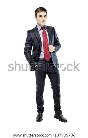 young attractive business man in black suite on white background - stock photo