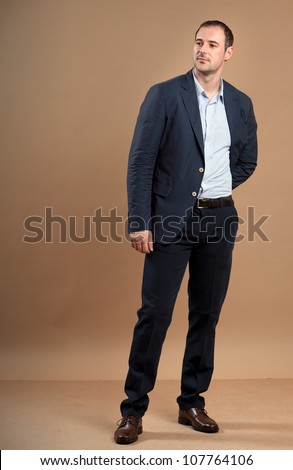 Young attractive business man in formal suit. - stock photo