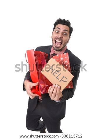 young attractive business man in stress holding lot of shopping bags and showing help sign tired bored and worried after expending too much money on gifts and presents - stock photo