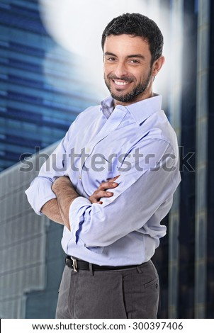 young attractive business man posing happy in corporate portrait outdoors on financial district background smiling with folded arms wearing casual businessman clothes in success concept - stock photo