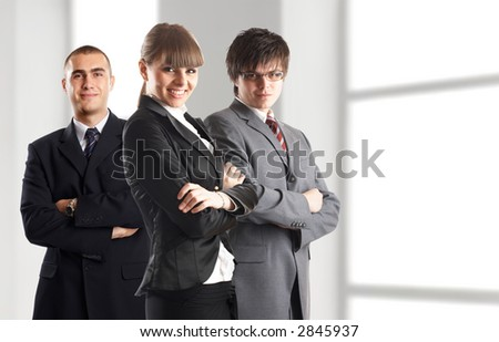 Young attractive business people - businesswoman and 2 businessman
