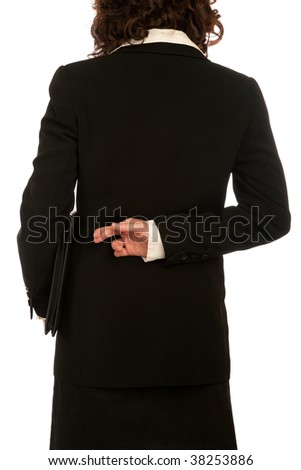 Young attractive business woman crossing fingers - stock photo
