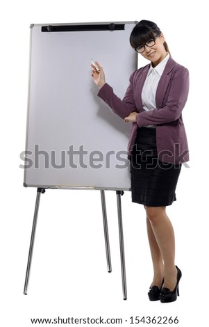 Young attractive business woman standing with a flip chart isolated over white background