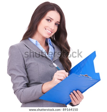 Young attractive business woman writing on clipboard, isolated on white background - stock photo