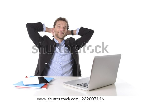 young attractive businessman happy and hectic at office work sitting at computer desk satisfied and smiling relaxed leaning on chair isolated on white background  - stock photo