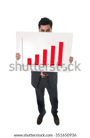 young attractive businessman in suit and tie holding and pointing business billboard panel with growth and positive development graphic in financial success and benefits concept - stock photo