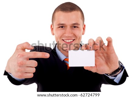 young attractive businessman shows his business card, focus is on card, face is blurred, white empty copy space, studio shoot isolated on white - stock photo