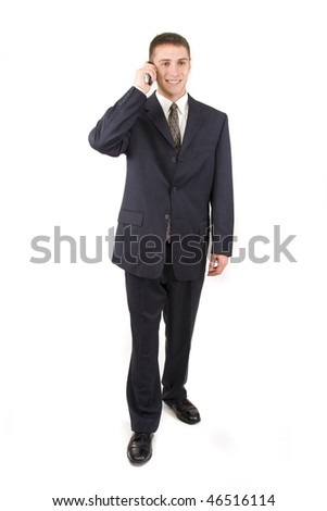 Young attractive businessman talking on a cell phone. - stock photo