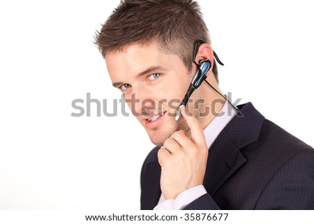 Young attractive Businessman talking on a headset - stock photo