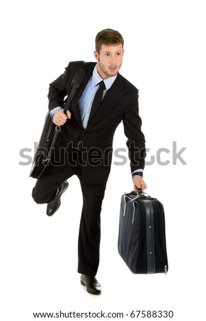 Young attractive businessman with briefcase and suitcase ready for traveling, man running. Studio shot. White background. - stock photo