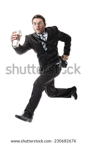 young attractive businessman with take away coffee running late to work wearing suit and tie hurry up to office in stress and overwork concept isolated on white background - stock photo