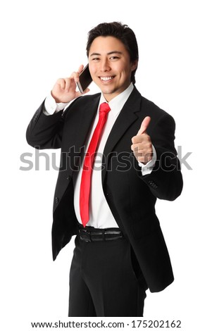Young attractive businessman working on the phone, wearing a suit and tie. White background. - stock photo