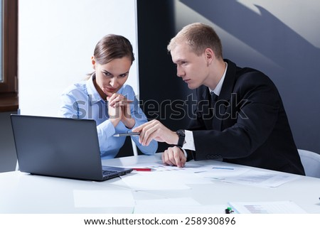 Young attractive businesspeople on theirs business meeting - stock photo