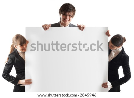 Young attractive businesspeople with white card in front