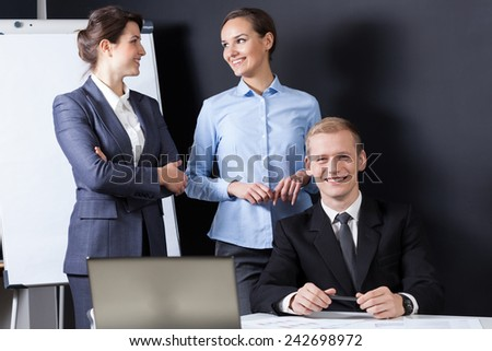 Young attractive businesspeople working in the office - stock photo