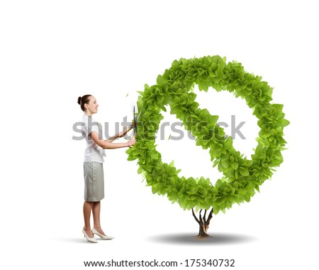 Young attractive businesswoman cutting plant in shape of prohibition sign - stock photo