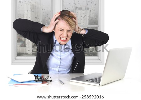 young attractive businesswoman frustrated and desperate expression at office working on computer laptop in stress at work concept screaming angry with sad rainy window view