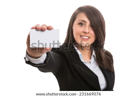 Young attractive businesswoman showing blank business card - stock photo