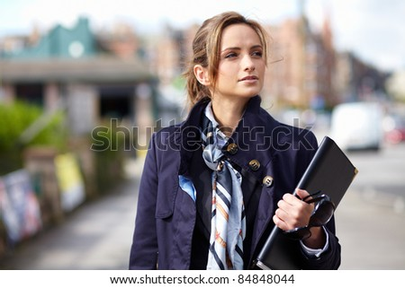 Young attractive businesswoman, street outdoor shoot