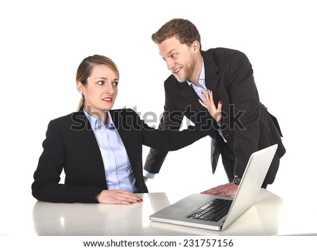 young attractive businesswoman suffering sexual harassment and abuse of colleague or office boss touching her in inappropriate behavior at work with excessive familiarity in work relationship concept