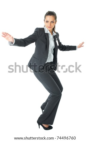 young attractive businesswoman try to hold balance, isolated on white background