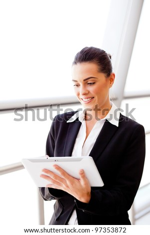 young attractive businesswoman using tablet computer - stock photo