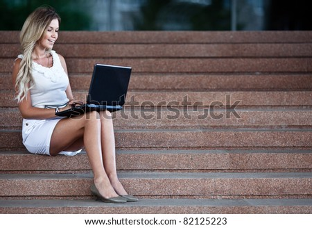 Young attractive businesswoman with a notebook - stock photo