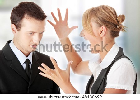 Young attractive caucasian business people arguing in office - stock photo