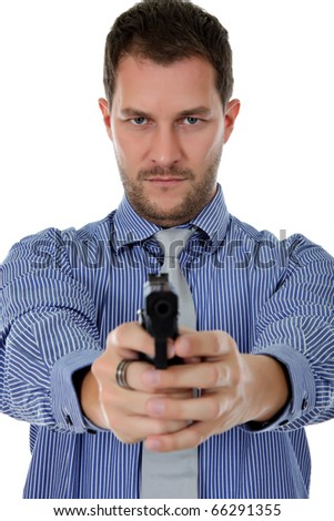 Young attractive caucasian businessman pointing with the gun. Focus on the face. Studio shot. White background. - stock photo