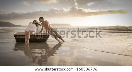 Young attractive caucasian couple relaxing beach leaning on vintage bath tub