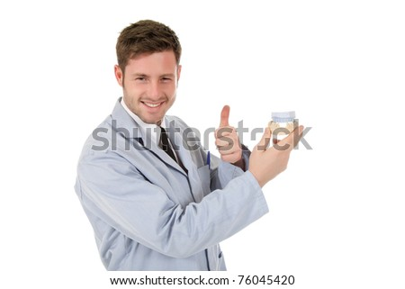 Young attractive caucasian male doctor dentist holding a plaster cast and gesturing thumb up. Studio shot. White background - stock photo