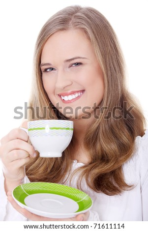 Young attractive corpulent blond woman drinking coffee - stock photo