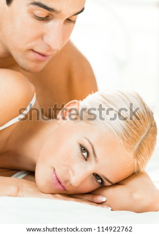 Young attractive couple at bedroom - stock photo
