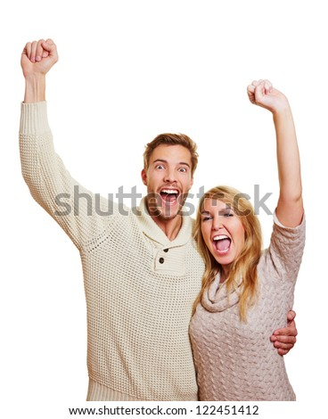 Young attractive couple cheering together with their clenched fists - stock photo