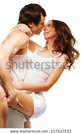 Young attractive couple dancing and about to kiss in intimate pose - stock photo